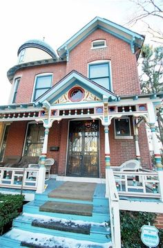 Now here's a pretty painted lady wraparound porch with colorful eye candy. This old Victorian for sale in Indianapolis had a great makeover inc the kitchen Victorian Homes Exterior, Victorian Porch, Victorian Style Homes, Victorian Cottage, Victorian Houses, Abandoned Mansion For Sale, Abandoned Mansions, Old Houses For Sale, Second Empire