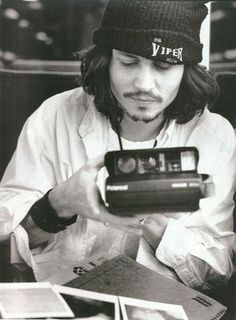 "Celebrity Photo Club ""Johnny Deep with his Polaroid"""
