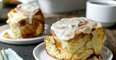 Sweet, tender cinnamon buns crowned with cream cheese icing.