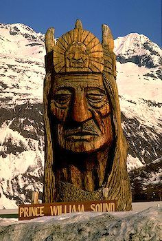 carving of a rugged Indian marks Prince William Sound near Valdez, Alaska.