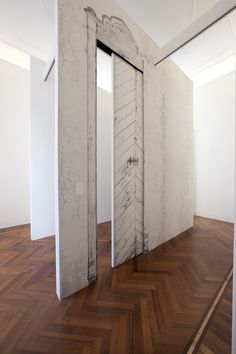 Linvisibile Motorized Concealed Sliding door, Showroom. Door covered with wallpaper.