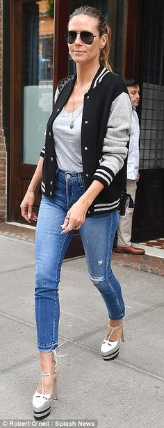 Heidi Klum steps out in varsity jacket and skinny jeans - - Heidi Klum, looked refreshed and ready to get back to work in a black and white varsity jacket that she paired with ripped skinny jeans as she ran errands in New York City on Monday. Adidas Vintage, Vintage Denim, Nicky Hilton, Nike Tech, Heidi Klum, Thom Browne, Hurley, Nike Sportswear, Beyonce