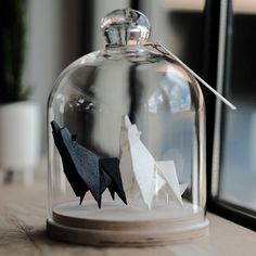 Floriane Touitou has a passion for origami. With her passion, she did what talented people do, she created some cool foldings of animals. She also added an extra layer of coolness with glass jars t…