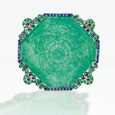 A Very Rare Art Deco Platinum, Carved Emerald, Emerald and Sapphire Brooch, Cartier, New York, Circa 1920