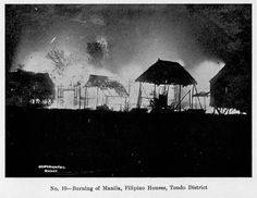 Nighttime view of the burning of Manila, with Filipino houses going up in flames, in the Tondo district, 1899.