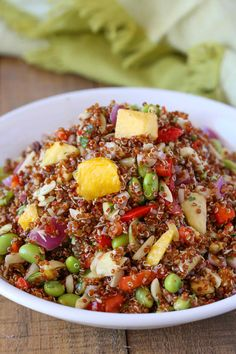 Tropical Quinoa Salad Recipe made with pineapple, mango, edamame and almonds toss in a honey lime vinaigrette is 5 smart points per serving.