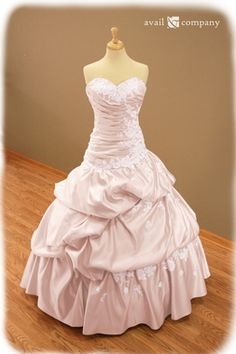 Blush Pink Wedding Dress - Angela Style - Avail & Company, LLC  This gorgeous dress is made of blush pink matte satin with a drop waist and ruched bodice. The dress displays bead work(clear beads and pearls) and lace. The dress also comes with attachable straps and a train.