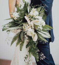 Swooning over this wild, desert-inspired bouquet of orchids, lotus seeds, jasmine, hellebores, tuberoses, and ferns | #BridesRealWedding : @logancolephoto : @megan_gray