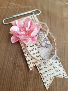 Embellishment on paperclip, paper flower