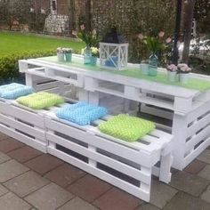 White has always grace in it whether its furniture or some thong else. This pallet tables and sitting bench looks amazing. The printed cushions and different vase give a nice appearance. A decoration piece is placed in the center of the table look cool. In the lawn, these white pallet outdoor furniture's presences make a completely relaxing environment.