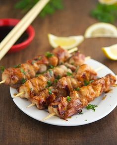 Teriyaki Glazed Chicken Kebabs  ¼ cup / 50 ml organic wheat-free soy sauce (or coconut aminos) ¼ cup / 55ml white wine ¼ cup / 60ml water 1 tablespoon raw organic honey (or raw coconut palm sugar) 1 teaspoon white vinegar 2 teaspoons grated fresh ginger 2 cloves garlic, minced bamboo skewers  2 lb / 900 gr free-range organic chicken breasts, cut into 1½-inch chunks Ground black pepper to taste