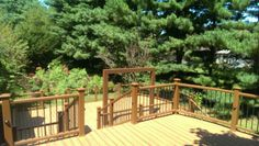 Large two level tiki torch deck with custom built area to mount a swing, a great place to relax and enjoy your new Trex Deck.