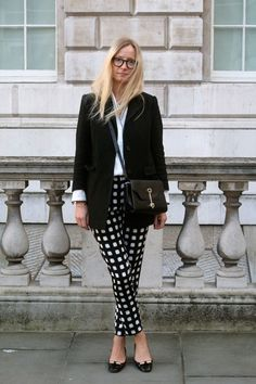 Martha is wearing Topshop printed trousers, H&M shirt, Madewell jacket, Jimmy Choos shoes and a Tod's bag.