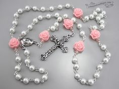 Lovely Girls white pearl rosary with light pink roses makes a nice gift for communion, confirmation, christening, baptism or any other special occasion. MATERIAL: The handmade unique Girls white pearl rosary is inspired from the traditional Catholic Five decade Rosary Design. 6mm