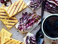 Grilled Polenta and Radicchio with Balsamic Drizzle | For your next party or gathering, keep your guests happy with these delicious starters. Becuase these platters are allplant-based, dairy-free, and completely vegan, more of your guests will be able to dig in and enjoy them. These dishes are a fantastic arrayof different flavors and ingredients that come together in a snap to create some truly remarkable and easy vegan appetizer options.