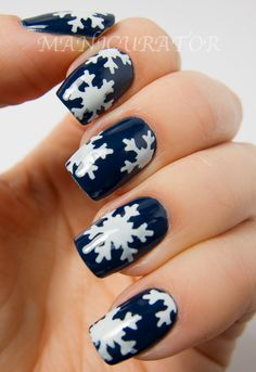 By victoria vertel. I used abase of 2 coats OPI I Saw...U Saw...We Saw...Warsaw. When it dries, use a craft punch on painters tape to cut out snowflake stencil. OPI My Boyfriend Scales Walls for the snowflakes! #holidaysSee more about it here: http://www.manicurator.com/2012/12/digit-al-dozens-holiday-week-snowflake.html