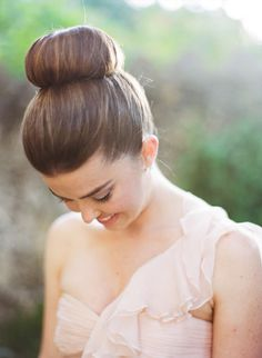 A pretty ballerina bun: http://www.stylemepretty.com/2014/05/22/croalgables-traditional-wedding/ | Photography: Julie Cate - http://juliecate.com/