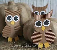 Cardboard owls, do wings w kid habds.