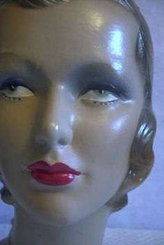 vintage mannequin with shiney forehead. I think she needs a visit to the powder room!