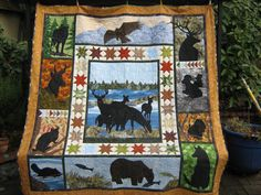 "Another June Jaeger quilt pattern (Log Cabin Quilts) called ""Into the Wild"". My version has deer in the wetlands instead of the forest."