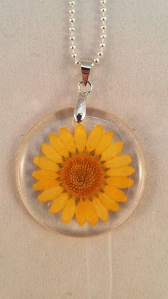 Hey, I found this really awesome Etsy listing at https://www.etsy.com/uk/listing/478902196/resin-dried-flower-pendants-yellow