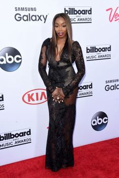 Last year, Kim Kardashian pointed to  a lacy black Givenchy gown as her favorite outfit of 2014. This look, on British musician Estelle, kind of looks like a watered down version of that.