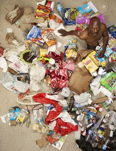 """Gregg Segal photographs people with a week's worth of their trash in his series, """"7 Days of Garbage."""""""
