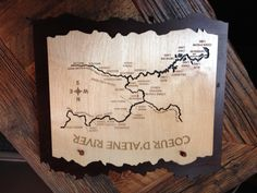 This is a new map design we just got in of the Coeur D' Alene River! The heavy wood cutout is a beautiful decorative piece for your home. We also have lakes as well! Come on down and see!