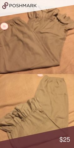 Plus size tan Linen wide leg pants with ruffles 90% linen , 10% rayon . Inseam is 32 with a 5 inch ruffle. Has two buttons on side of pants at side of bottom of pants. Wanna B  Pants Wide Leg