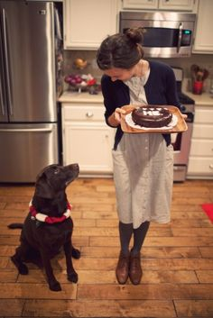 Reminds me of my dog when Im cooking.....except hes usually standing up at the counter. Just waiting.... :)