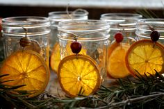 dried orange and cranberry Yule lanterns.. can also used as ornaments