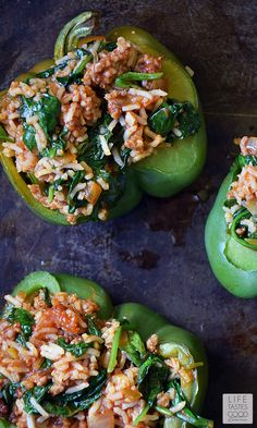 Green Peppers | by Life Tastes Good are stuffed with a mixture of turkey sausage, spinach, fresh herbs & Basmati rice in a spicy salsa topped off with ooey gooey cheese are easy to make and packed full of exciting flavors. #LTGrecipes