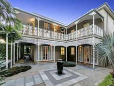 Renovated Queenslander with wrought iron balustrades at Sherwood, Qld 4075 #queenslanderhomes