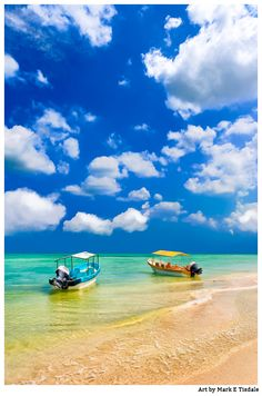 Little Boats On The Yucatan Coast - Beautiful tropical beach with colorful boats in the sea on the gulf coast in Mexico