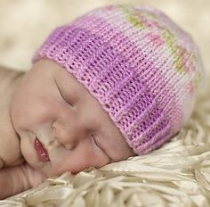 Free Pattern: Not-all-Purple Newborn Hat by Olha. Bernat Baby Jacquards is a self-patterning yarn that creates floral design resembling Fair Isle technique.