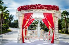 Suhaag Garden Indian Wedding, Florida Indian Wedding Decorator, California Indian Wedding Decorator, Red Pink and Ivory Drapes, Red and Pink Flowers, Crystal Mandap, Outdoor Indian Wedding, Traditional White Mandap, Elephants