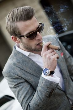 Grey suit, crisp white shirt and skeleton watch.