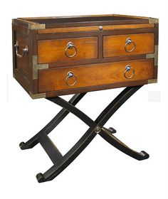 """Bombay Box: High-ranking British officers enjoyed a lifestyle """"under canvas"""" that allowed the transportation of luxuriously appointed furnishings, designed to travel well and serve their owners in the style to which they were accustomed. Despite their substantial and stylish appearance, the pieces were cleverly designed to quickly break down and re-assemble without the use of nails or tools, in time for afternoon tea or an evening """"encamp""""."""