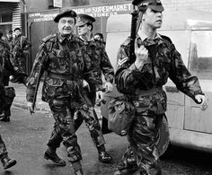 Lieut. General Sir Harry Tuzo, GOC Northern Ireland, (centre) with a Military Police escort in Newry. Ref #: PA.1703356 Date: 06/02/1972