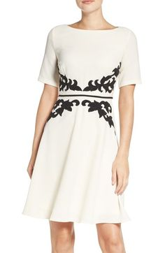 I love this simple elegance of this dress and how the applique emphasizes the waist.