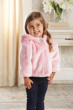 This perfectly pink luxe baby coat is the top of the line when it comes to comfort and style. The pink faux fur coat features satin lining and jeweled snap closure. Part of Mud Pie's Pretty in Pink collection. Girly girls get their kicks from feminine flair. Our Pretty in Pink collection captures pure femininity in the best color for girls, pink! Available in sizes 0-6 months, 9-12 months, 12-18 months and 2T-3T.