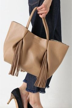 GIANNI CHIARINI chic with fringes