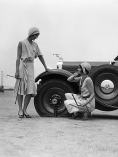 1930s Two Women Confront an Automobile Flat Tire Photographic Print at AllPosters.com