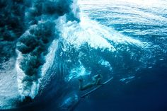 """What an amazing photo!!  Underwater photographer Sarah Lee uses a technique known as """"duck diving"""" to capture these stunning photos of surfers in Hawaii."""