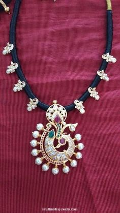 Gold peacock black thread necklace adorned with rubies, emerald and pearls. For inquiries please contact Neminath Jewellers, 092909 Gold Jewellery Design, Bead Jewellery, Beaded Jewelry, Gold Jewelry, Latest Jewellery, Diamond Jewellery, Rope Necklace, Beaded Necklace, Necklace Set