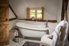 Cozy English Cottage bathroom - Inside the 'Faerie Door' in Wiltshire, England English Country Cottages, Home, Thatched Cottage, Cottage Interiors, House Bathroom, House, Fairytale Cottage, Cottage Bathroom, Faerie Door