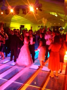 Wedding Guests dancing the night away on Starr Tent's clear plexi seamless dance floor pool cover!