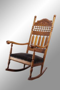 Antique Tall Carved Stick and Ball Oak Rocker, exactly like mine except my seat is burgundy/wine color.  For more info go to: WWW.MaineAntiqueFurniture.Com