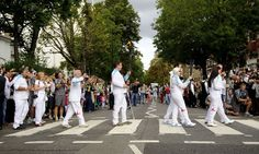 The Paralympic Torch Relay walk over the Abbey Road crossing