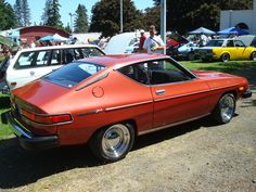 haha!  My first car: a red '77 Datsun 200sx  (not this actual car, but you know what I mean...)